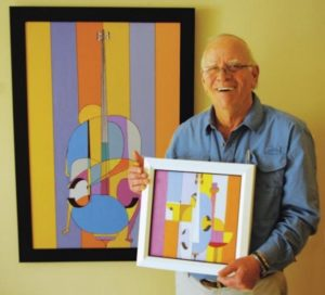 elisha-ben-yitzhak-holding-artworks